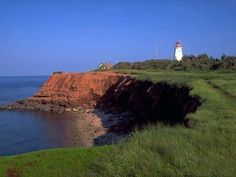 Quintessential Prince Edward Island, Canada - red dirt cliffs, green growing stuff, bluest water & sky, and a lighthouse! Great Places, Places To See, Beautiful Places, Beautiful Scenery, Canada Real Estate, Just Dream, Prince Edward Island, Canada Travel, Vacation Spots