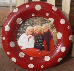 How creative is this?  A recycled tire used as a picture frame!  So adorable!!!!!