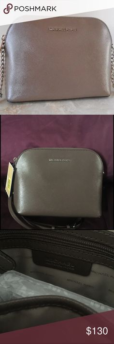 "Michael Kors Cindy Crossbody NWT MICHAEL KORS CINDY LARGE DOME LEATHER CROSSBODY. NWT. Beautiful neutral color.  Color:  Cinder   *Saffiano metallic leather  *Silver tone hardware  *Zip top closure  *MK logo lettering at front   *Interior features zip pocket, 1 slip pocket and key fob  *Adjustable strap with up to 25"" drop    *7""(H) x 9""(L) x 3 1/2""(D) Michael Kors Bags Crossbody Bags"