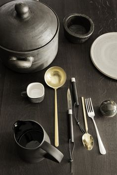 I like the deep wood tones in these kitchen stills photographed by Heidi Lerkenfeldt.These dark wood and sand tones combined with the brass accessories have a certain level of sophistication to them that I'm really drawn to.