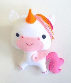 Felt toy, Soft toy white Unicorn with pink wings and orange horn.