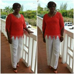Orange crochet top with white linen pants, and matching orange shoes. Casual yet classy.