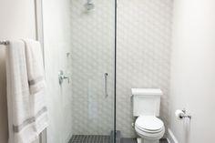 Textured Tile Jack and Jill Bath #whiteandbeige #wallsconce #mirror #wood #textures #silverhardware #greenery #tile #rug #decor #towels #towelrack #toilet  #shower #wallpaper #textured #walkinshower #interiordesigner #saralynnbrennan #interiors #saralynnbrennaninteriors #interiordesign #waxhaw #waxhawinteriordesign #charlotte #charlottedesign #charlotteinteriordesign #currentdesignsituation Jack And Jill, Transitional Bathroom, Tiles Texture, Interior Decorating, Interior Design, Cozy House, Pools, Greenery, Toilet