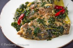 Fried tilapia in Coconut Milk is a Filipino dish locally known as Ginataang Tilapia. This version makes use of fried tilapia along with malunggay leaves