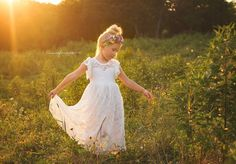 This stunning white lace flower girl dress is made from the softest lace. Delicate lace flutter sleeves make this dress feel so whimsical. Front of…