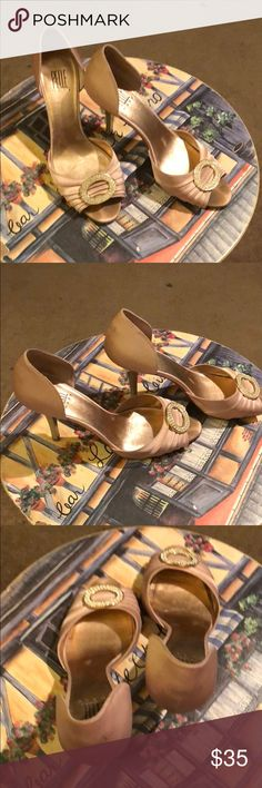 Shoes Light pink satin heels with bling hardware. A couple spots on back of heel but not noticeable, foot print in toe of shoe. In vet good condition. From my personal closet. Pelle Moda Shoes Heels
