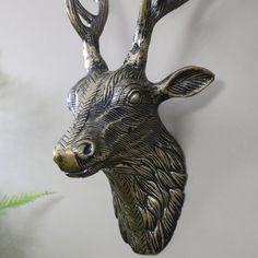 Replica Gold Metal Wall Mounted Stag Head Wall mounted replica stag head in gold with black distressing, stunning wall art