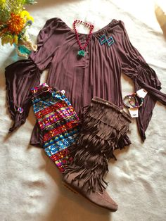 Brown tunic with sharkbite sleeve small-large Regular one size leggings fringe mocs show necklace serape bracelets and ring all available on our website. Or purchase direct from Pinterest with the app