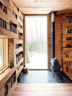 This tiny black cabin by US firm Studio Padron serves as a cosy library and guest house for a vacation home in upstate New York.