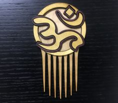 We make our Om Comb out of Yellowheart and Bubinga hard woods with an Maple cross-fiber core.  For our Natural Hair lovers Black Yogis and Yoga Practitioners everywhere!  www.Carbon-ar.com