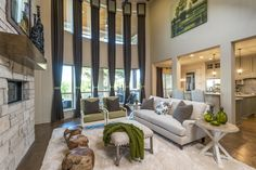 Discover your #dreamhome in #Austin with a spacious #livingroom that opens to the #gourmet #kitchen. #furniture #curtains #interior #design #fireplace