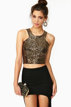 All that glitters aint gold but this sure is mighty lovely. Cutaway Sequin Crop Top from #NastyGal. #Fashion #WinterTrends