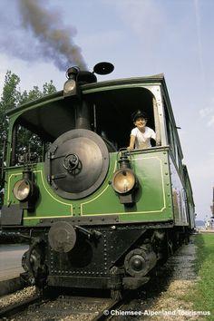 """Chiemseebahn in Prien am Chiemsee - die älteste Dampfstraßenbahn der Welt! The railroad """"Chiemseebahn"""" in Prien at the lake Chiemsee is one of the eldest steam trams in the world! Bavaria"""