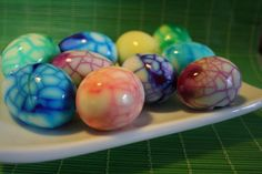 Coloring Eggs for Easter: 1. Boil eggs. 2. Crack shell. 3. Dip in colored water (food color) 4. Peel shell off.