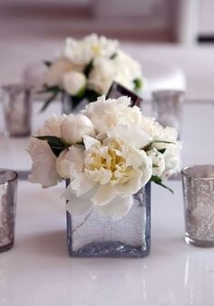 White And Pale Peach Flower Arrangements In Clear Glass