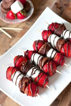 Easy Strawberry Brownie Bites | For the bite-sized brownies, you can use your favorite recipe or boxed brownie mix and a mini muffin tin.  Once baked, the mini brownies are skewered with marshmallows, fresh strawberries and drizzled with chocolate sauce.  These kebabs would also be delicious with raspberries or fresh pineapple.