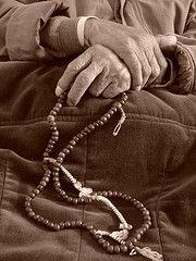 Praying the rosary - vintage photo