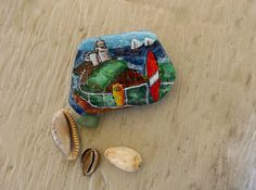 """""""Surfing at the Lighthouse"""" painted rock in stunning colours on https://www.facebook.com/pages/The-Stunner-Boutique/456809484484281"""