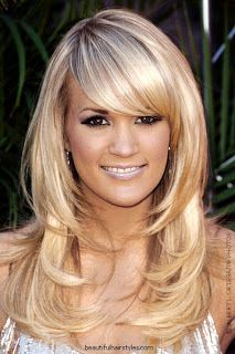 Like the way the layers lay in this cut, but longer or no bangs.