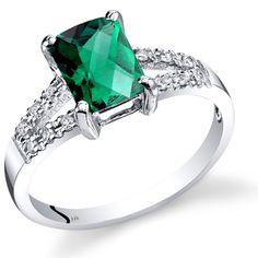 14K White Gold Created Emerald Diamond Venetian Ring 1.25 Carats Total. Created Emerald, Radiant Cut, 8x6 mm, 1.25 Carats. Natural Diamonds, 12 pieces, Round Brilliant Cut, 0.12 Carats Total. Ring is in 14 Karat White Gold. Perfect Gift for Christmas, Mothers Day, Graduation, Birthdays, Weddings, Anniversary. Includes Gift Box and Money Back Guarantee.