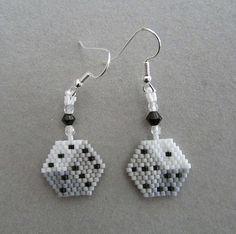 These handcrafted Dice earrings are just the thing for your next trip to Las Vegas or Atlantic City. The variation of color allows for a 3-D look even though the earrings themselves are actually flat. They would make a great finishing touch to your outfit for the next Monte Carlo