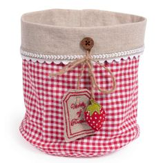 I love the way this fabric basket is labeled using a button with a tag! - - - Fabric basket with strawberry