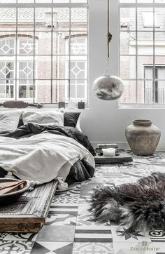 Eclectic decor with minimal palate and bed on floor
