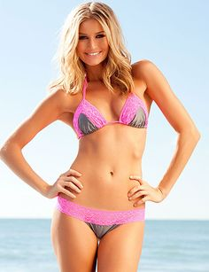 You'll definitely be the hottest girl at the beach this Summer in our new Lace Trim Scrunch Bikini Tri Top! Featuring an adjustable triangle style top that ties at the neck and back with lace trim outlining on both triangles. Durably made from Lycra and fully lined.      ATTENTION!! Complete the set with the Lace Trim Scrunch Butt Brazilian Bikini Bottoms,