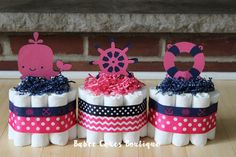 Set of 3 Mini Nautical Diaper Cakes, Hot Pink and Navy Nautical Shower Centerpiece Decor, Girls Nautical Baby Shower by BabeeCakesBoutique on Etsy https://www.etsy.com/listing/193832856/set-of-3-mini-nautical-diaper-cakes-hot