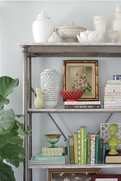 Styling your bookshelf via The Lovely Cupboard