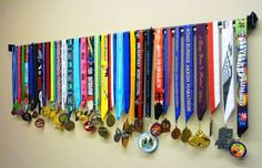 "idea to hang medals Another pinner said "" I'm doing this for my husband's running medals. Finally out of the closet and where people can see this hobby that he loves."" I hope I have this many one day"