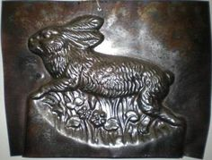 Old chocolate molds including rabbits, Santas and other favorites