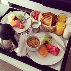Fruits, hot coffee, bread, orange juice, milk and cereal.                                                                                                                                                                                 More