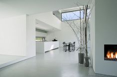 #Kitchen Idea of the Day: Modern white kitchens. Cute, white luxury island fireplace loft table