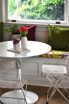 """""""The breakfast area was created by building a window seat with built-in storage."""""""