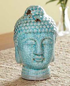 Bless yourself with the peace of Buddha as you embark on your own personal journey toward enlightenment. Glazed in a beautiful turquoise with a ''distressed'' crackle finish, our Ceramic Buddha Head is a calming figure in the midst of a chaotic world. Focus your gaze on his tranquil countenance as you clear your mind prior to meditating, use him as a gentle reminder to surround yourself with positive energy, or simply enjoy the serene beauty the blue-green color brings to your home.