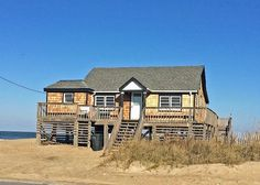 This cute Kitty Hawk oceanfront rental sleeps up to 8. Newly remodeled for 2015.