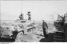 Rommel's armoured forces had ranged far and wide since November, first making a strong probing attack, then retreating in good order. German soldiers in a 'Schützenpanzer', North Africa, January 1942.