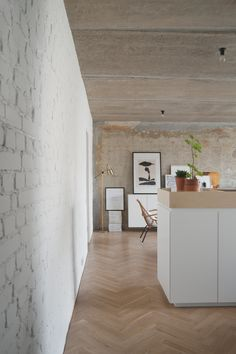 Concrete Ceiling Apartment is a minimalist house located in Moscow, Russia, designed by Crosby Studios.