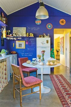 Fun room Looks like chalkboard paint in amazing blue.The yellow room around the corner looks amazing too.