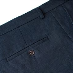 100% Linen Trousers in Classic Fit Dark Navy Linen Trousers with crease, double back pockets with button closure, waistband with beltloops, slanted front pockets.