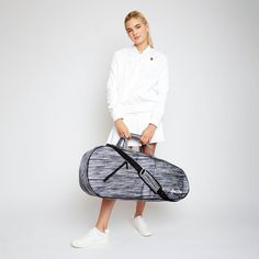 "Ame & Lulu 3 Racquet Tennis Bag (Black Grunge) (Model #3RB192)  Structured nylon. Zip closure. Removable, adjustable shoulder strap. Exterior zip pocket. Fits three racquets. Interior zip pocket. Nylon liner. Three interior slip pockets. 31.5""L x 7""W x 13""H. Color: Black  #womenstennisbag #ameandlulu #womenstennis #tennisbag"