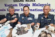 Foiled attempt: Paddy with KLIA customs director Datuk Hamzah Sundang (left) and deputy director Abd Wahid Sulong showing the seized pangolin scales in Sepang.