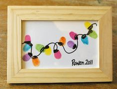 Beneath the Rowan Tree: Christmas Card :: Thumb Print String of Lights Definitely going to get some IKEA frames and have my students make these for their parents as a gift this holiday season! Christmas Projects, Winter Christmas, All Things Christmas, Christmas Lights, Holiday Crafts, Holiday Fun, Christmas Holidays, Christmas Decorations, Christmas Ideas