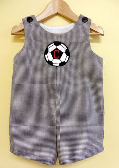 This classic shortall features black/white gingham and a soccer ball applique with an optional one letter initial. Sizes: 6m, 9m, 12m, 18m 2 & 3. Only $28. Shopping our flash sale is fun and shipping is free! www.facebook.com/jdoriginals