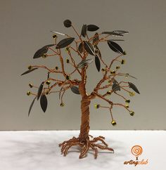 Another version of our beloved olive tree, the ultimate #Greek product. Made of cooper wire, metal bronze leaves and gold-green glass beads for olives. — www.artingclub.eu