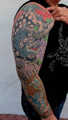 The above mentioned designs make for some amazing Irezumi tattoo design ideas.A sneak pee Japanese Tattoo Designs, Japanese Tattoo Art, Japanese Sleeve Tattoos, Foo Dog Tattoo, Dog Tattoos, Body Art Tattoos, Lion Tattoo, Arm Tattoo, Japanese Foo Dog