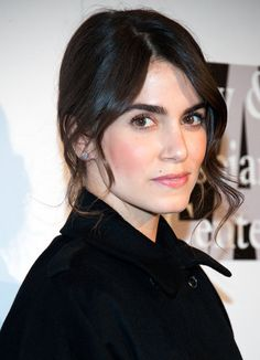 Nikki Reed's makeup is perfection here - glowy, healthy skin and rosy lips.