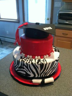 Marisa's Graduation Cake 2012 - Made for my friend's granddaughter.  Used Wilton's sugar sheets for zebra, very nice product.
