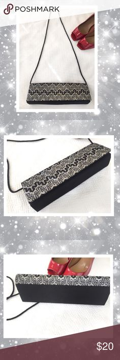 "Sparkly satin evening purse by Bijoux Turner Black and silver! Glitter and shine. Perfect bag for your holiday party. 11"" wide by 3.5"" tall. Strap length appx 40"" High quality bag. Like new condition. Snaps in front. Bijoux Turner Bags"